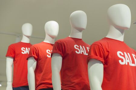 Male mannequins with t-shirts with the inscription Sale