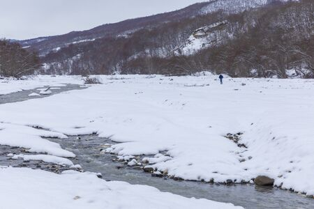 River passing through a mountain gorge in winter Zdjęcie Seryjne
