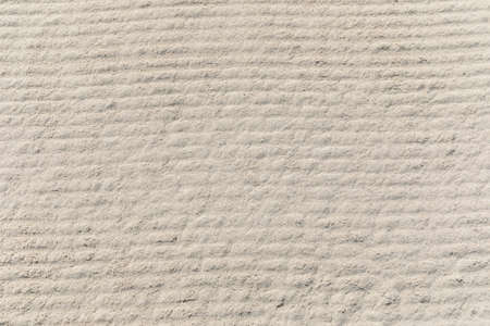 Texture of white sand on the beach Фото со стока
