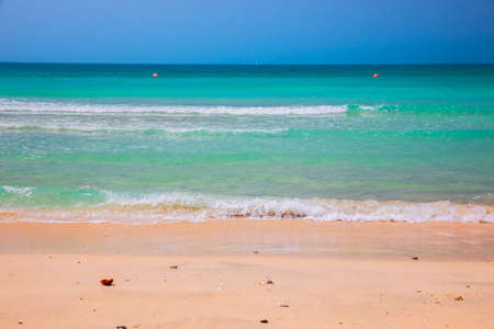 Rolling turquoise waves ashore in Dubai