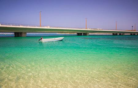 Boat moored next to the shore Фото со стока
