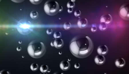 Abstract background. Chrome spheres of different sizes on a dark background Imagens