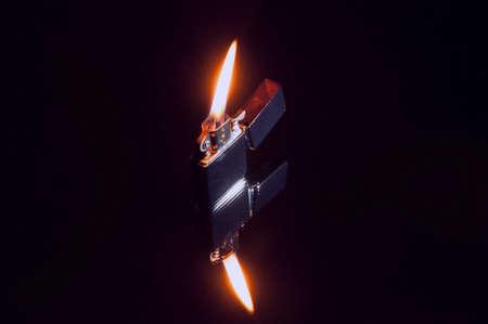Zippo lighter lit Stok Fotoğraf