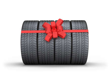 Car tires with red bow. 3d image. Isolated white background.