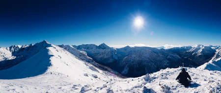 top mountain: Mountain landscape with snow and clear blue sky