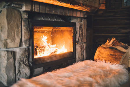 Warm cozy fireplace with real wood burning in it.