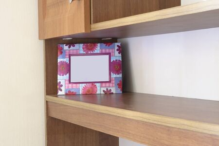 the photo frame on the shelf