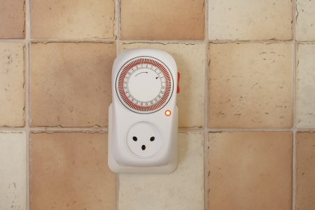 electricity timer on the wall Stock Photo