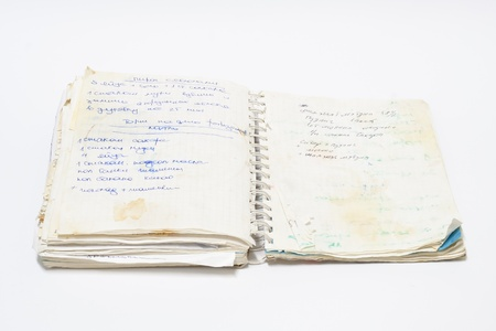 old spiral notebook with records Editorial
