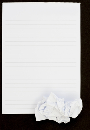 Notebook black background open view and crumpled paper Stock Photo
