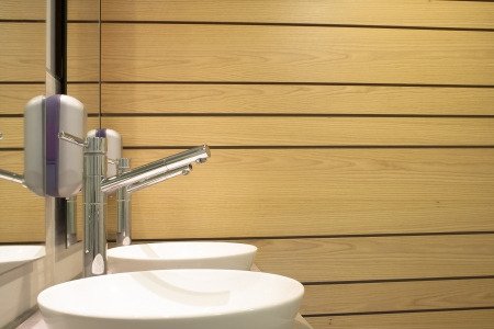 Washbasin and wooden bathroom wall reflected in the mirror Stock Photo - 16848323