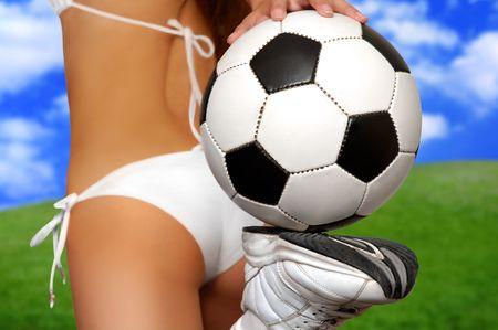 Girl in bikini with soccer ball on juicy green field Stock Photo - 747554