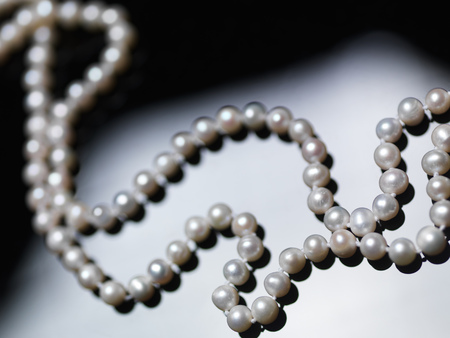 Pearl necklace beads on black and white background Imagens