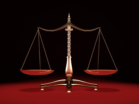 Balanced brass weight scales Law and Justice symbol Isolated on black red background