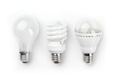Three generations of light bulbs. Regular incandescent, energy saving fluorescent and LED isolated on white background with clipping path Banco de Imagens