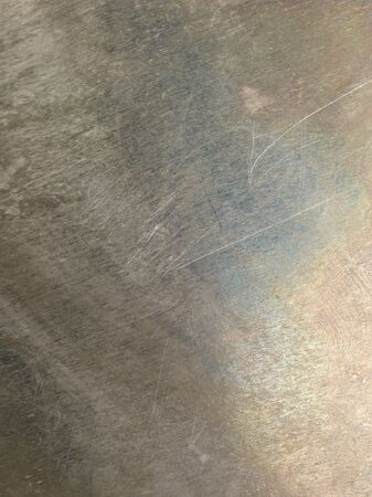 Oxidized scratched grungy shiny metal texture background