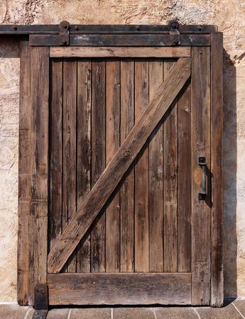 Old sliding wooden door rustic texture Standard-Bild