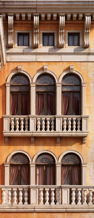 Arched windows of a house texture in Venetian gothic architectural style.