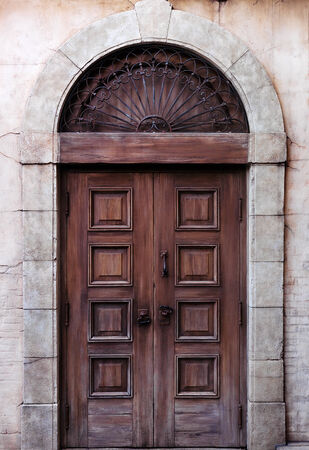 Old arched wooden door rustic vintage architectural detail texture Banco de Imagens