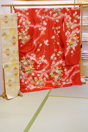 Red silk Japanese Kimono and Obi belt on display in a store in Tokyo, Japan.