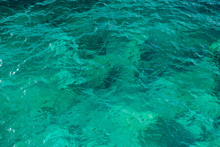 Clear green wavy sea water texture background