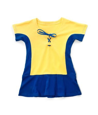 Cute yellow blue childrens dress kids clothes isolated on white background Banco de Imagens