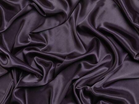 Black shiny silky fabric abstract background texture Banco de Imagens