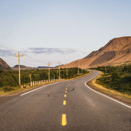 Twisting road running beside the Tablelands in the Gros Morne National Park in Newfoundland, Canada Banque d'images - 133685815