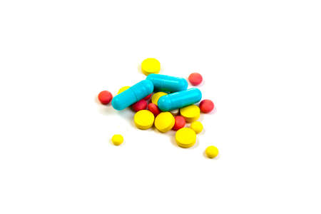 antibiotic pink pill: Colored pills, tablets and capsules on a white background Stock Photo