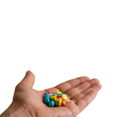 antibiotic pink pill: Colored pills, tablets and capsules in hand