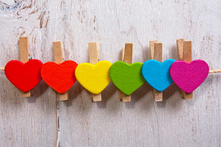 heart rainbow of colors on a white wooden background,LGBT symbol Standard-Bild