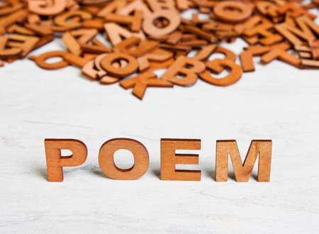 bookish: Word Poem made with wooden letters on a background of other blurred letters