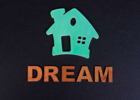 dreamlike: green house and the dream of the word of the letters on a black background