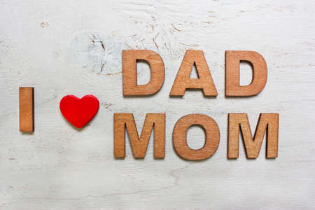 i love dad mom with wooden letters on an old white wooden background stock photo