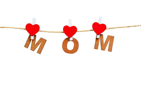wood letters and heart forming mom on  white  background,isolate