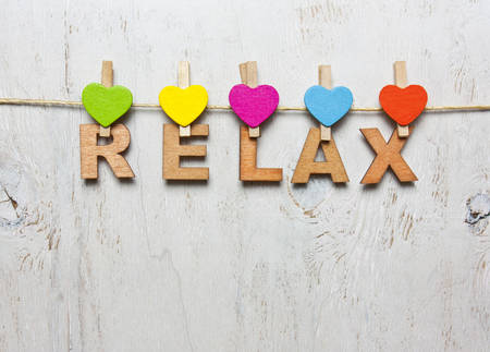 clothespins: Word relax of wooden letters on a white background with wooden clothespins Stock Photo