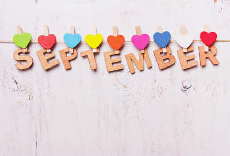 single word: the word september   letters on a wooden clothespins on a white background old Stock Photo