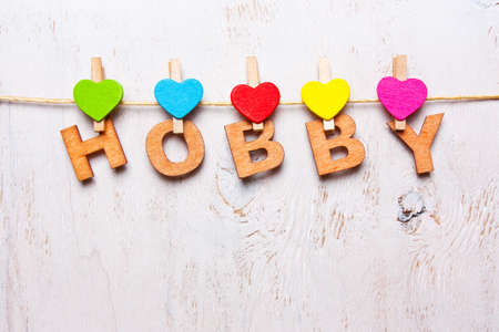 the word hobbyl of the wooden letters on a white background