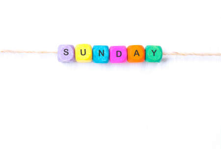sunday word of multicolored cubes on a white background