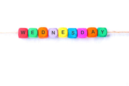 wednesday: WEDNESDAY word of multicolored cubes on a white background