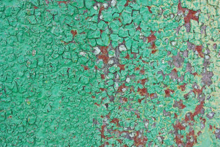 oxidate: Green rusty background, rough, rough texture in the cracks. Corrosion of metal iron. The Army, the city banner, billboard