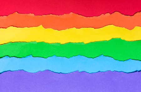 Rainbow flag made of paper, LGBT symbol. horizontal multicolored stripes