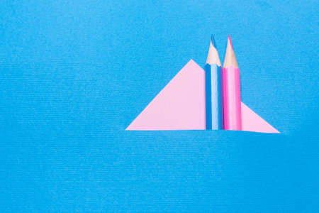 The pink and blue pencils on paper, the concept of minimalism