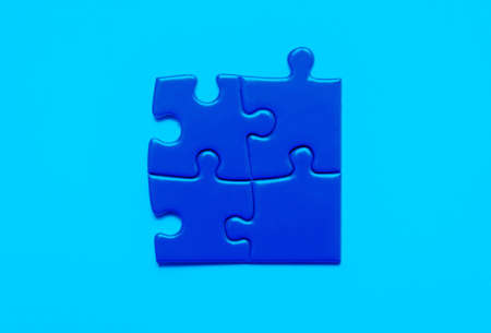 Blue puzzles, the concept of success, the task is completed Stock Photo