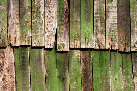 Old antique green wooden groung the background,rustic wall or table