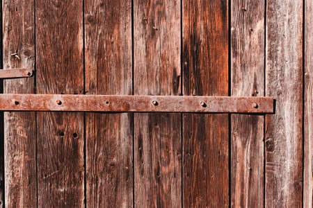 Old antique  wooden groung the background with rusty iron nails and a staple,rustic wall or table Stock Photo