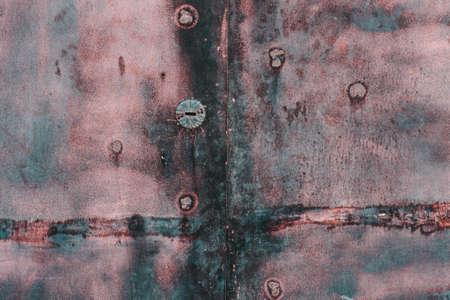 Rusty black old metallic door, grunge background Stock Photo