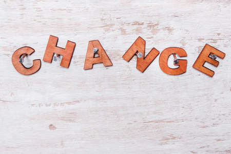 word change of wooden letters on a white background nailed Stock Photo