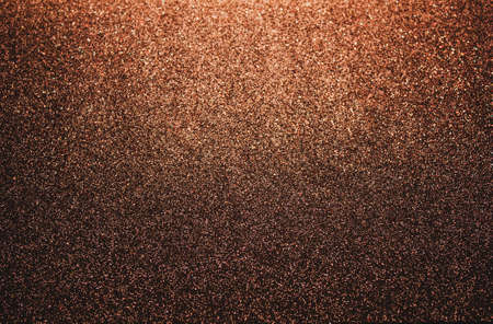 Golden abstract blurred glitter background, festive. Glitter texture. Christmas, New Year