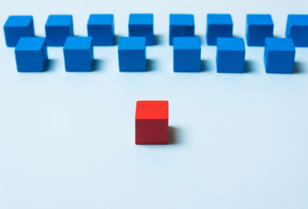 Blue and red cubes. Leadership concept. Soft focus